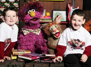 Pictured with Hilda, Potto and Archie from Sesame Tree are Jimmy and Martin Dundon from St Marys PS, Belfast
