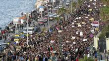 In this photo taken Saturday, Jan.29, 2011, a crowd demonstrate in Alexandria, Egypt. Thousands of Alexandrians met to pray Sunday Jan 30 in downtown Alexandria, a Mediterranean port city that is a stronghold of the Muslim Brotherhood. After prayers, the crowd marched towards the city's old mosque to pray for the souls of those who died in the protests.(AP Photo/Tarek Fawzi)