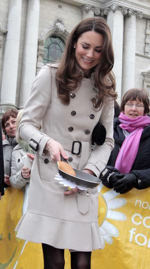 ©Jonathan Porter/Presseye.com - Press Eye Ltd -Northern Ireland -  8th March 2011.  Prince William  and his future wife Kate Middleton make their first official visit to Northern Ireland.  The Royal couple pictured starting their visit at Belfast's City Hall and Miss Middleton tosses a pancake for the Northern Ireland Cancer Fund for Children.  The Prince is set to marry Miss Middleton in April.