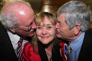 DUP's Michelle McIIveen tops the poll in Srangford and is congragulated by Jim Shannon (left) and Robert Gibson  at the election count at Ards Leisure Centre