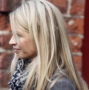 Louise Speed leaves Warrington Coroners' Court after an inquest into his death