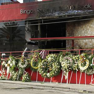 A makeshift memorial lines the driveway of the Casino Royale in Monterrey, Mexico (AP)