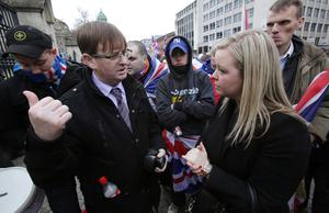 Willie Frazer talks to Sara Girvin as loyalist protestors converge on Belfast city hall. Picture date: Saturday January 5, 2013