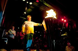 Simon Weston lights the Welsh National Flame cauldron at the  evening celebration site, Cardiff, Wales