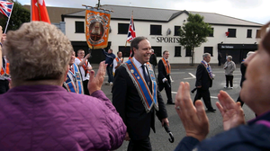 The DUP's Nigel Dodds pictured along with other Orange men and bands in 2012 as they make their way past the Ardoyne shops in north Belfast.