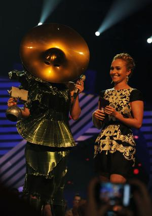 BELFAST, NORTHERN IRELAND - NOVEMBER 06:  Singer Lady Gaga receives the Best Song award for 'Born This Way' from actress Hayden Panettiere onstage during the MTV Europe Music Awards 2010 live show at at the Odyssey Arena on November 6, 2011 in Belfast, Northern Ireland.  (Photo by Dave Benett/Getty Images)