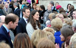 Alan Lewis - Photopress Belfast   8/3/2011Prince William and Kate Middleton enjoying the crowds as they take a walkabout in the grounds of Belfast City Hall today. There was a heavy security presence but, with Prince William close by, Miss Middleton joined children tossing pancakes and stopped for a chat with women in the grounds of City Hall. Armed police officers patrolled the streets and kept watch from nearby rooftops, but the opening engagement of the couple's one-day visit passed without incident. Security considerations meant there was no pre-visit announcement by Buckingham Palace and the Northern Ireland Office.