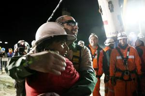 SAN JOSE MINE, CHILE - OCTOBER 12: (NO SALES, NO ARCHIVE) In this handout from the Chilean government, Mario Sepulveda, 39, the second miner to exit the rescue capsule, receives a hug October 12, 2010 at the San Jose mine near Copiapo, Chile. The rescue operation has begun bringing up the 33 miners, 69 days after the August 5th collapse that trapped them half a mile underground. (Photo by Hugo Infante/Chilean Government via Getty Images)