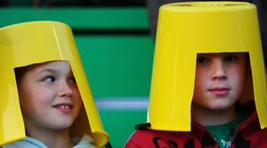 PALMERSTON NORTH, NEW ZEALAND - SEPTEMBER 28:  Young Romania fans wear cut out buckets during the IRB 2011 Rugby World Cup Pool B match between Georgia and Romania at Arena Manawatu on September 28, 2011 in Palmerston North, New Zealand.  (Photo by Mike Hewitt/Getty Images)