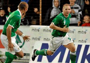 Billy Kee celebrates scoring for Northern Ireland at the Milk Cup in 2009.