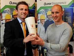 Down coach Paddy Tally (right) receives the UGAAWA Merit Award for July, on behalf of Martin Clarke, from Quinn Insurance Sales & Marketing Co-ordinator Rory Rafferty