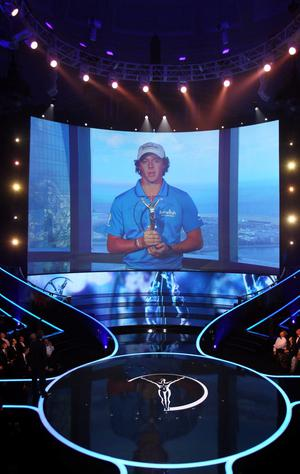 LONDON, ENGLAND - FEBRUARY 06:  Rory McIlroy winner of the Laureus World Breakthrough of the Year accepts his trophy via a video recording during the 2012 Laureus World Sports Awards at Central Hall Westminster on February 6, 2012 in London, England.  (Photo by Matthew Lewis/Getty Images for Laureus)