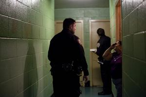 NEW YORK, NY - OCTOBER 28: A New York City police officer speaks to a woman as he goes door to door in a housing project to take note of which residents are ignoring the mandatory evacuation order as Hurricane Sandy approaches on October 28, 2012 in the Rockaway Beach neighborhood of the Queens borough of New York City. New York City Mayor Michael Bloomberg announced a mandatory evacuation on low-lying coastal areas of the city.  Sandy, which has already claimed over 50 lives in the Caribbean is predicted to bring heavy winds and floodwaters to the mid-Atlantic region. (Photo by Allison Joyce/Getty Images)