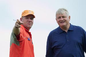 John Daly of the USA with businessman Denis O'Brien plays during the first round of The JP McManus Invitational Pro-Am event at the Adare Manor Hotel and Golf Resort on July 5, 2010 in Limerick