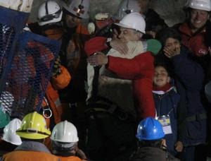 Chile's President Sebastian Pinera embraces miner Florencio Avalos after he was rescued from the collapsed San Jose gold and copper mine where he was trapped with 32 other miners for over two months near Copiapo, Chile.(AP Photo/Roberto Candia)