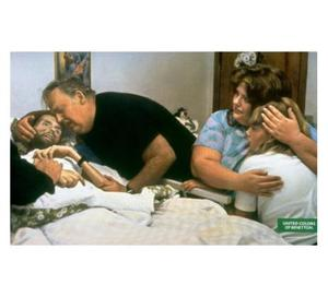 This Benetton advert features a photo of Aids sufferer and activist David Kirby and his family by Therese Frare (1990). The original picture, which won the World Press Photo Award, was published in black and white, but Benetton's advertisers decided they wanted to use a colour version to make it seem more shockingly like a real ad. The ad was designed to raise awareness of Aids and Kirby's family and Frare approved of the photos use. But it provoked a storm of criticism from other Aids activists who claimed the campaign was in some way a vindication of homosexuality.
