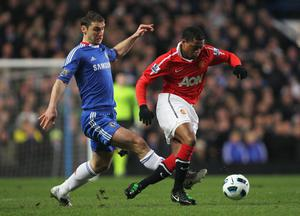 LONDON, ENGLAND - MARCH 01: Patrice Evra of Manchester United is challenged by Branislav Ivanovic of Chelsea during the Barclays Premier League match between Chelsea and Manchester United at Stamford Bridge on March 1, 2011 in London, England.  (Photo by Clive Rose/Getty Images)