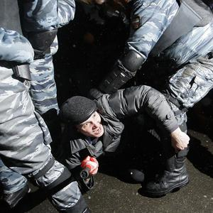 Russian riot police detain protesters during a rally on Pushkin square in Moscow (AP)