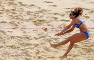 LONDON, ENGLAND - AUGUST 01:  Vasiliki Arvaniti of Greece hits over the net during the Women's Beach Volleyball Preliminary match between China and Greece on Day 5 of the London 2012 Olympic Games at Horse Guards Parade on August 1, 2012 in London, England.  (Photo by Ryan Pierse/Getty Images)