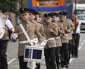 South Down Defenders parade through the streets of Newry City. 12 July 2011