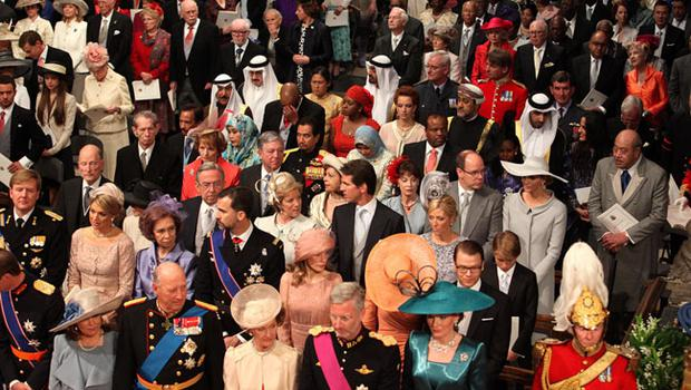 Guests stand for the arrival of Queen Elizabeth II in Westminster Abbey in London, where Prince William and Kate Middleton will marry later today. PRESS ASSOCIATION Photo. Picture date: Friday April 29 2011. Photo credit should read: Anthony Devlin/PA Wire