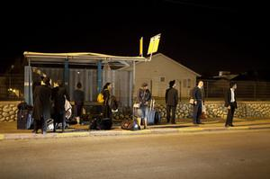 NETIVOT, ISRAEL - NOVEMBER 14:  (ISRAEL OUT ) People wait for a bus to leave town on November 14, 2012 in Netivot, Israel. Israel Defense Forces launched aerial attacks on targets in Gaza that killed the top military commander of Hamas, (Photo by Uriel Sinai/Getty Images)