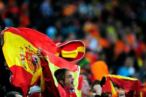 A Spain fan enjoys the atmopshere ahead of the 2010 FIFA World Cup South Africa Final match between Netherlands and Spain at Soccer City Stadium on July 11, 2010 in Johannesburg, South Africa