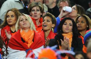 Sylvie Van der Vaart (C), wife of Rafael Van der Vaart of the Netherlands enjoys the atmosphere ahead of the 2010 FIFA World Cup South Africa Final match between Netherlands and Spain at Soccer City Stadium on July 11, 2010 in Johannesburg, South Africa