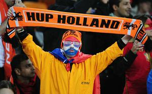 A Netherlands fan enjoys the atmosphere prior to the 2010 FIFA World Cup South Africa Final match between Netherlands and Spain at Soccer City Stadium on July 11, 2010 in Johannesburg, South Africa