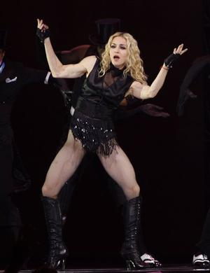 """Madonna performs during her """"Sticky and Sweet"""" tour Wednesday Oct. 15, 2008 in Boston. Madonna and Guy Ritchie announced earlier Wednesday that they are divorcing after nearly eight years of marriage. (AP Photo/Bizuayehu Tesfaye)"""