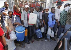 People line up for gas at a gas station in the aftermath of the Tuesday's earthquake in Port-au-Prince, Friday, Jan. 13, 2010.