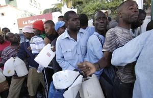 People line up to for gasoline in Port-au-Prince, Haiti  Friday, Jan. 15, 2010.