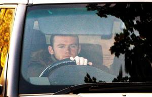 Manchester United's Wayne Rooney leaves the Carrington Training ground in Manchester. PRESS ASSOCIATION Photo. Picture date: Friday October 22, 2010. England striker Wayne Rooney is staying at Manchester United after signing a new deal in a dramatic u-turn, having previously stated his desire to leave Old Trafford.