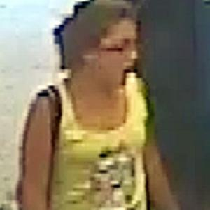 Tia Sharp wearing a yellow vest top with an image of an animal on the front, caught on CCTV from the Co-op in Addington on August 2