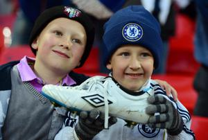 LONDON, ENGLAND - APRIL 15:  Young fans celebrate with John Terry of Chelsea's boot after victory in the FA Cup with Budweiser Semi Final match between Tottenham Hotspur and Chelsea at Wembley Stadium on April 15, 2012 in London, England.  (Photo by Mike Hewitt/Getty Images)
