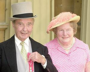 Dick Francis, who has died at the age of 89 and wife Mary,who died in 2000, after he received his CBE