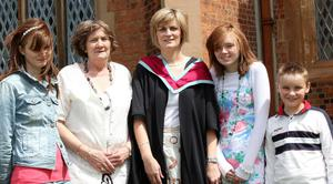 Graduations at Queen's University Belfast.  Paula Smyth(centre) from Castledawson who graduated with a Masters in Communication pictured with(left to right) her daughter Lauren(16), mother Anne Kane, daughter Leah(14) and son Ethan(10).