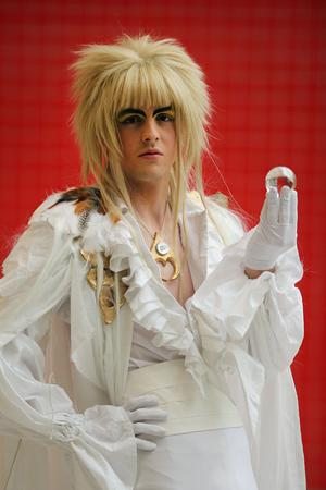 LONDON, ENGLAND - OCTOBER 26:  John Kennedy 19, from Dublin, 18, poses as Jareth from Labyrinth ahead of the MCM London Comic Con Expo at ExCel on October 26, 2012 in London, England. Visitors to the Comic Convention are encouraged to wear a costume of their favourite comic character and flock to the Expo to gather all the latest news in the world of comics, manga, anime, film, cosplay, games and cult fiction.  (Photo by Dan Kitwood/Getty Images)