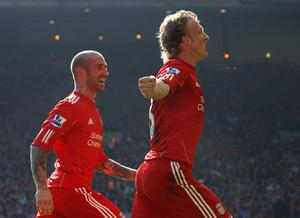 LIVERPOOL, ENGLAND - MARCH 06:  Dirk Kuyt of Liverpool celebrates scoring his team's second goal with team mate Raul Meireles (L) during the Barclays Premier League match between Liverpool and Manchester United at Anfield on March 6, 2011 in Liverpool, England.  (Photo by Alex Livesey/Getty Images)