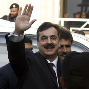 Pakistani Prime Minister Yousuf Raza Gilani arrives at the Supreme Court in Islamabad (AP)