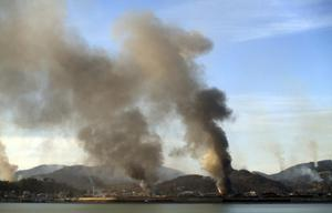 Smoke rises from South Korea's Yeonpyeong island near the border against North Korea Tuesday, Nov. 23, 2010. North Korea fired artillery barrages onto the South Korean island near their disputed border Tuesday, setting buildings alight and prompting South Korea to return fire and scramble fighter jets. (AP Photo/Yonhap) KOREA OUT