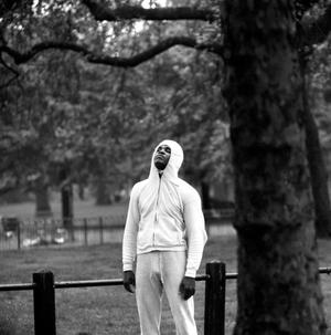 28/05/1963: Cassius Clay taking a breather during an early morning run through Hyde Park.