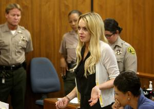 Actress Lindsay Lohan (L) and lawyer Shawn Chapman Holley attend a probation revocation hearing at the Beverly Hills Courthouse on July 6, 2010 in Los Angeles, California. Lindsay Lohan was found in violation of her probation for the August 2007 no-contest plea to drug and alcohol charges stemming from two separate traffic accidents, she is scheduled to surrender on July 20, 2010 to serve her 90 day jail sentence
