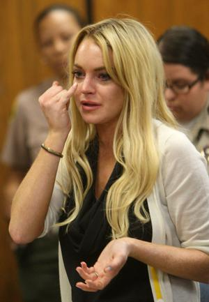 Actress Lindsay Lohan attends a probation revocation hearing at the Beverly Hills Courthouse on July 6, 2010 in Los Angeles, California. Lindsay Lohan was found in violation of her probation for the August 2007 no-contest plea to drug and alcohol charges stemming from two separate traffic accidents, she is scheduled to surrender on July 20, 2010 to serve her 90 day jail sentence