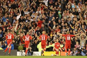 LONDON, ENGLAND - MAY 09:  Maxi Rodriguez of Liverpool celebrates scoring in front of the Liverpool fans during the Barclays Premier League match between Fulham and Liverpool at Craven Cottage on May 9, 2011 in London, England.  (Photo by Scott Heavey/Getty Images)