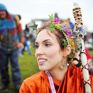 Druid Tia Daisy, 25, from Seattle, joins revellers celebrating the Summer Solstice at Stonehenge, Wiltshire