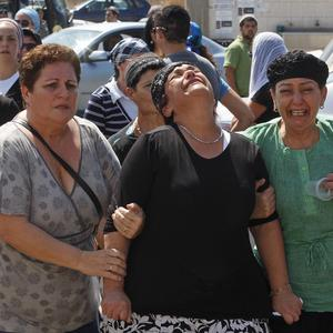 Relatives of Kochava Even Haim react during her funeral in the city of Ashdod, Israel (AP)