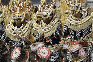 Drummers perform during a carnival parade by the Mocidade Alegre samba school in Sao Paulo, Brazil, early Sunday, Feb. 19, 2012. Carnival runs Feb. 17-21. (AP Photo/Andre Penner)
