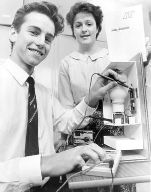 Mark Wright (17), a lower sixth pupil at Methody, who came top in the Northern Ireland GCSE technology exams. Mark, who lives in Malone, is pictured with his teacher Mrs. Audrey Reid and his automatic liquid soap dispenser which was his project for the exam. This is the fourth time in six years that a Methodist College has won this award, 1990.