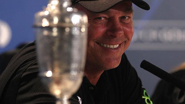 Northern Ireland's Darren Clarke looks over at the Claret Jug during a press conference after the 2011 Open Championship